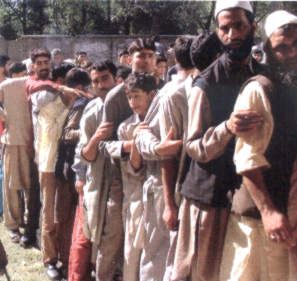 Kashmiris queueing up to vote in the 2002 October polls